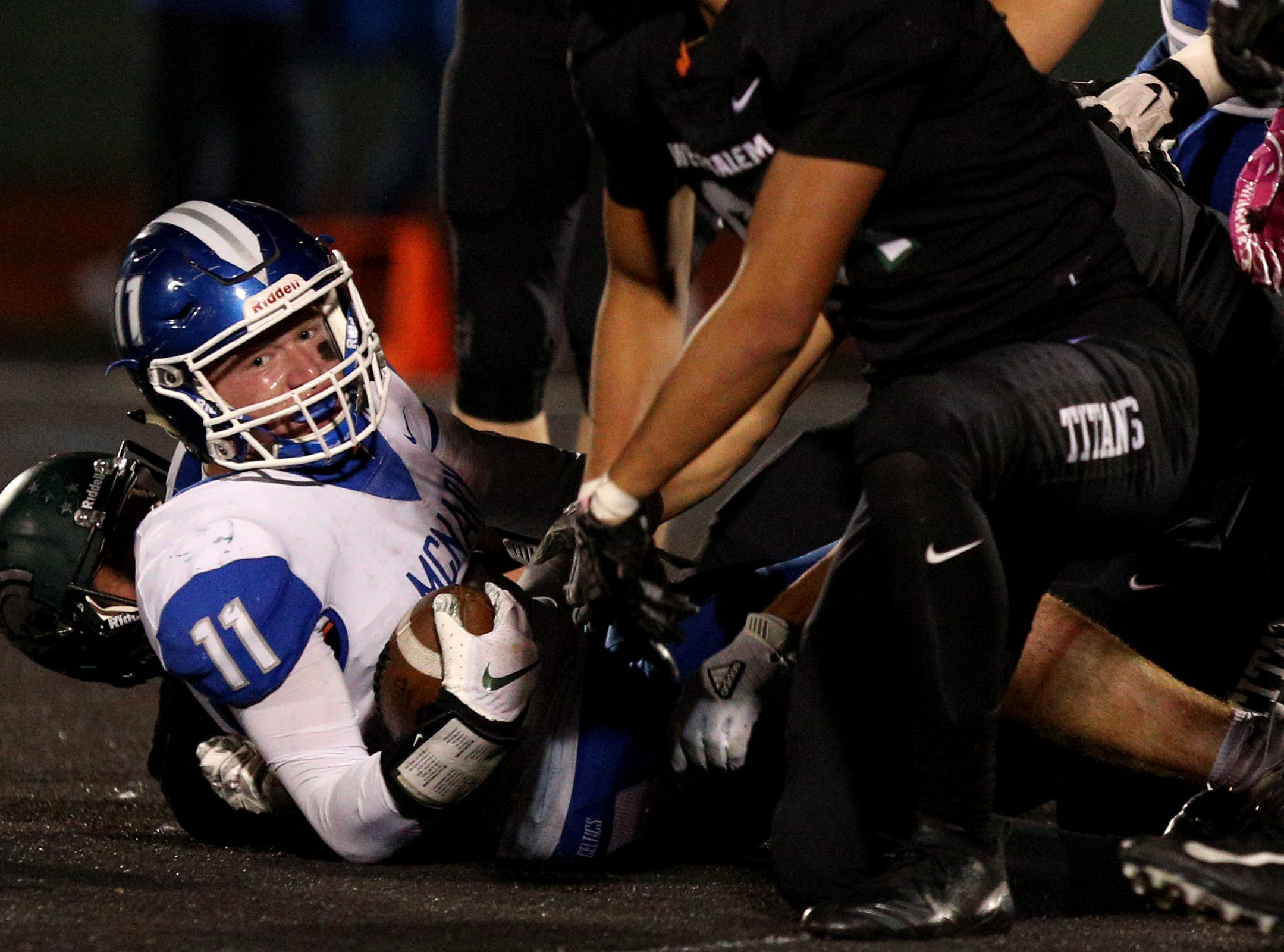 McNary's Noah Bach (11) is taken down during the first half of the McNary vs. West Salem football game at West Salem High School on Friday, Oct. 19.