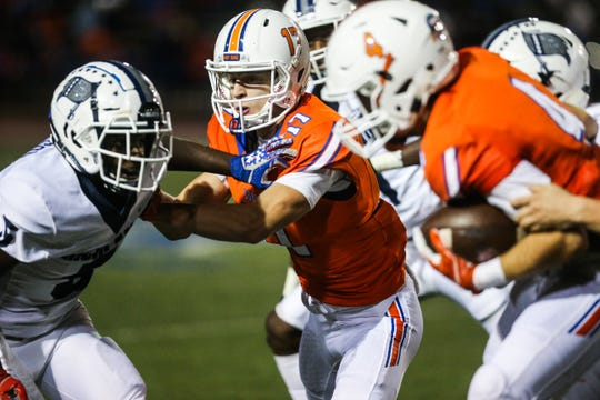 Central's Tanner Dabbert, center, blocks a Richland defender as Jackson Timme picks up yardage after a reception Friday, Oct. 19, 2018, at San Angelo Stadium.