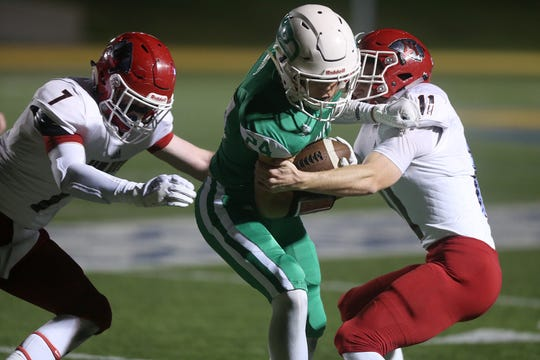 Wall's Kve Herbert (#24) tries to break free from Jim Ned's Joshua Kelso (#11) and Ty Doty (#7) during the game Friday, Oct. 19, 2018 at LeGrand Stadium.