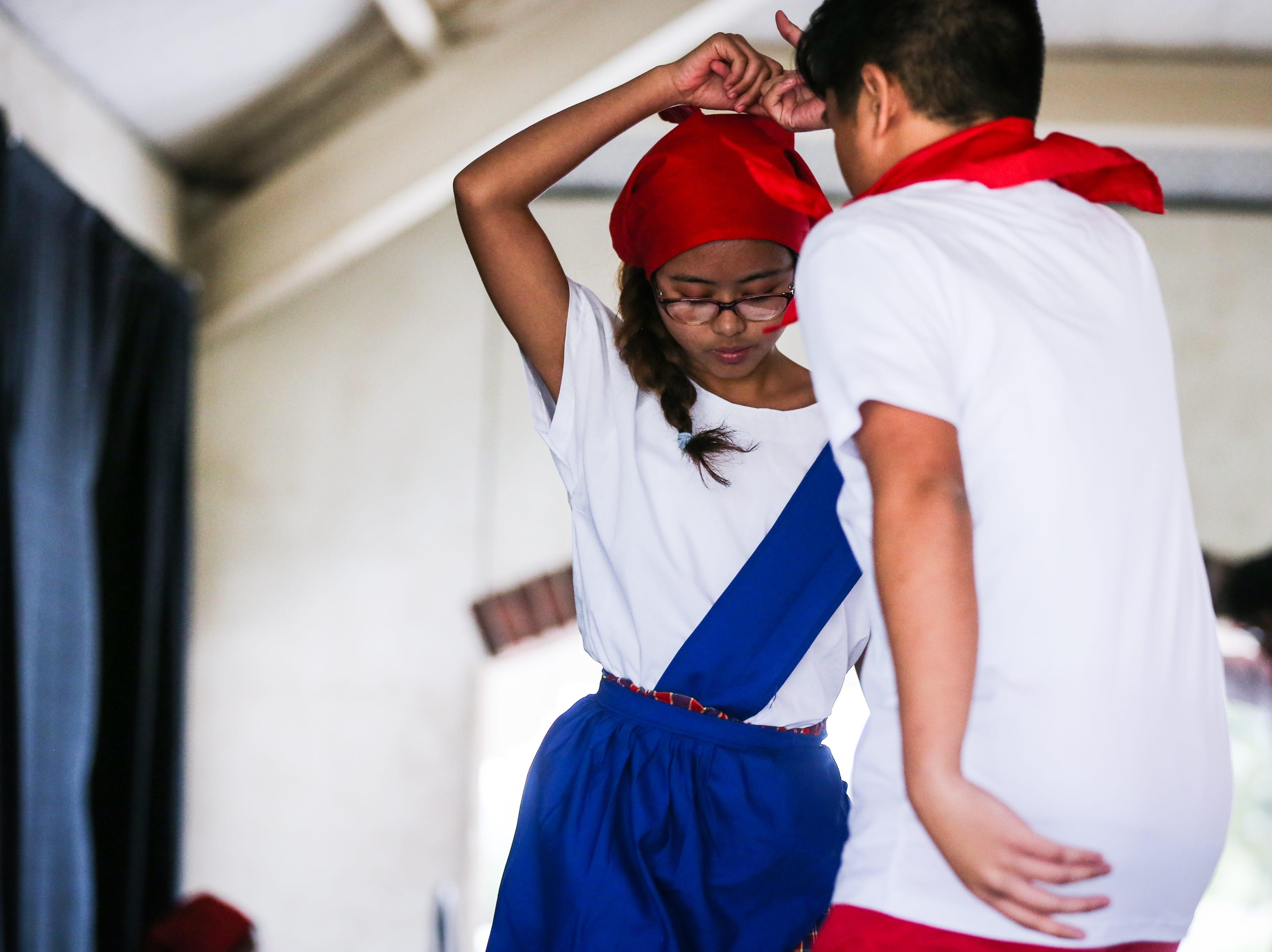 Teens dance the Tinikling, a traditional Philippine folk dance, during the Asian Bazaar Saturday, Oct. 20, 2018, at El Paseo de Santa Angela.