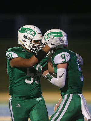 Wall's Kalani Celaya (58) celebrates with teammate Mason Fuchs (9) after a touchdown against Jim Ned during a District 3-3A Division I football game Friday, Oct. 19, 2018 at LeGrand Stadium.