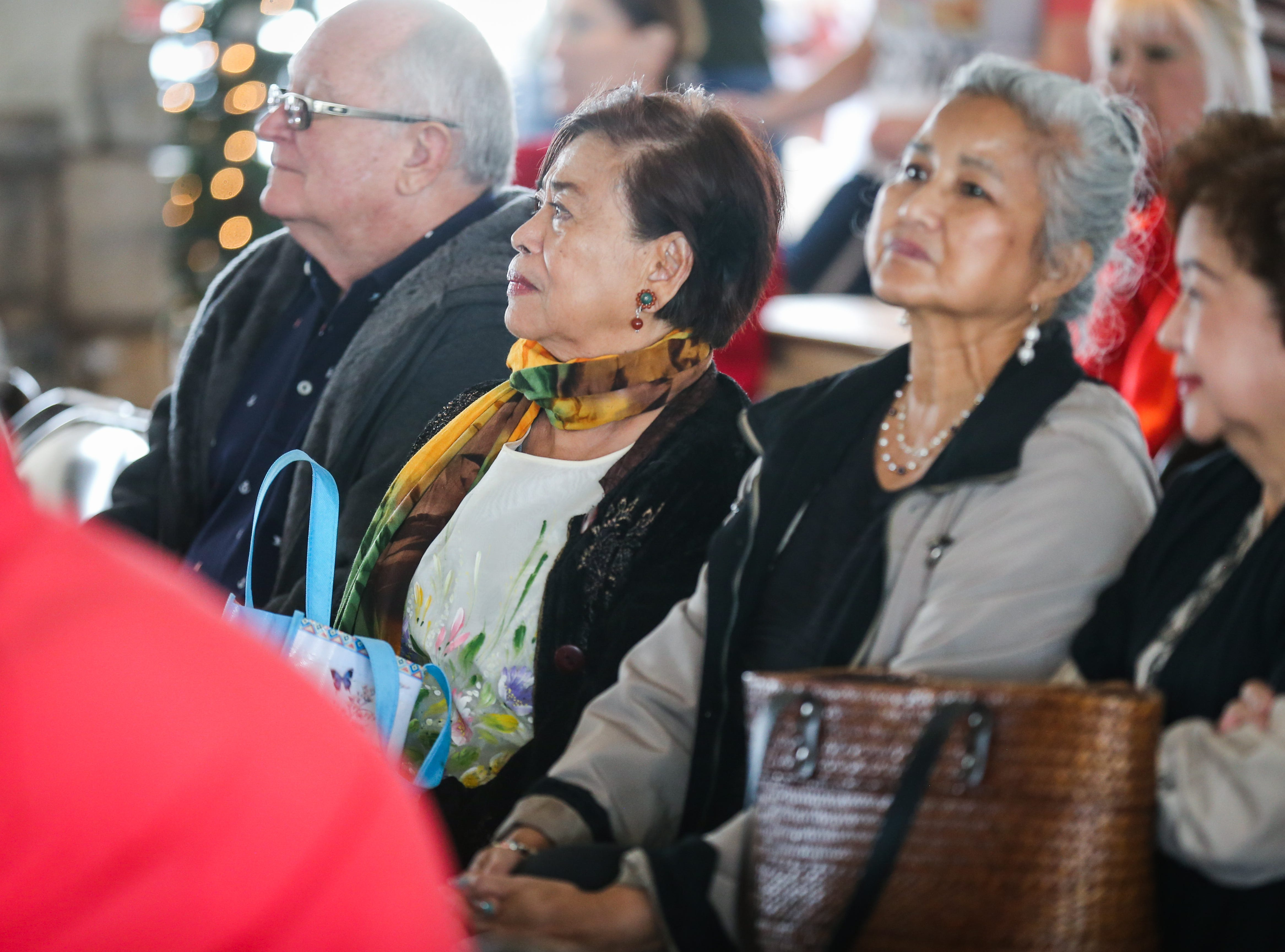 Attendees fill the sits for the Tinikling dance during the Asian Bazaar Saturday, Oct. 20, 2018, at El Paseo de Santa Angela.