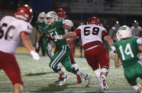 Wall's Tate Jones (#51) pushes past Jim Ned's Sawyer Higgins (#68) during the game Friday, Oct. 19, 2018 at LeGrand Stadium.