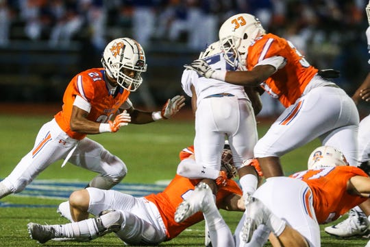 Central's Malik Finley and Xy'kerion Paulk block Richland ball carrier Friday, Oct. 19, 2018, at San Angelo Stadium.
