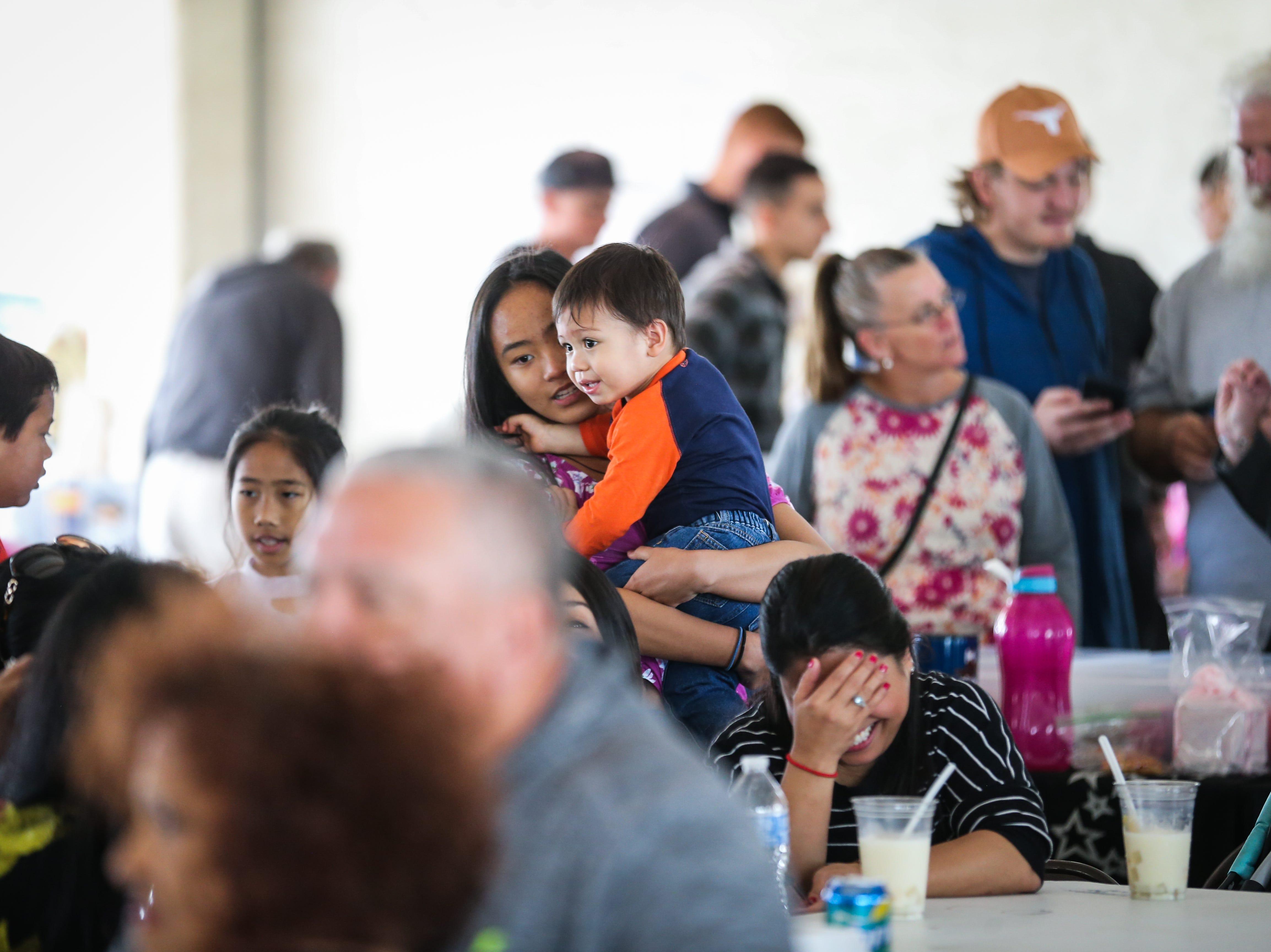 Families and friends hang out at the Asian Bazaar Saturday, Oct. 20, 2018, at El Paseo de Santa Angela.