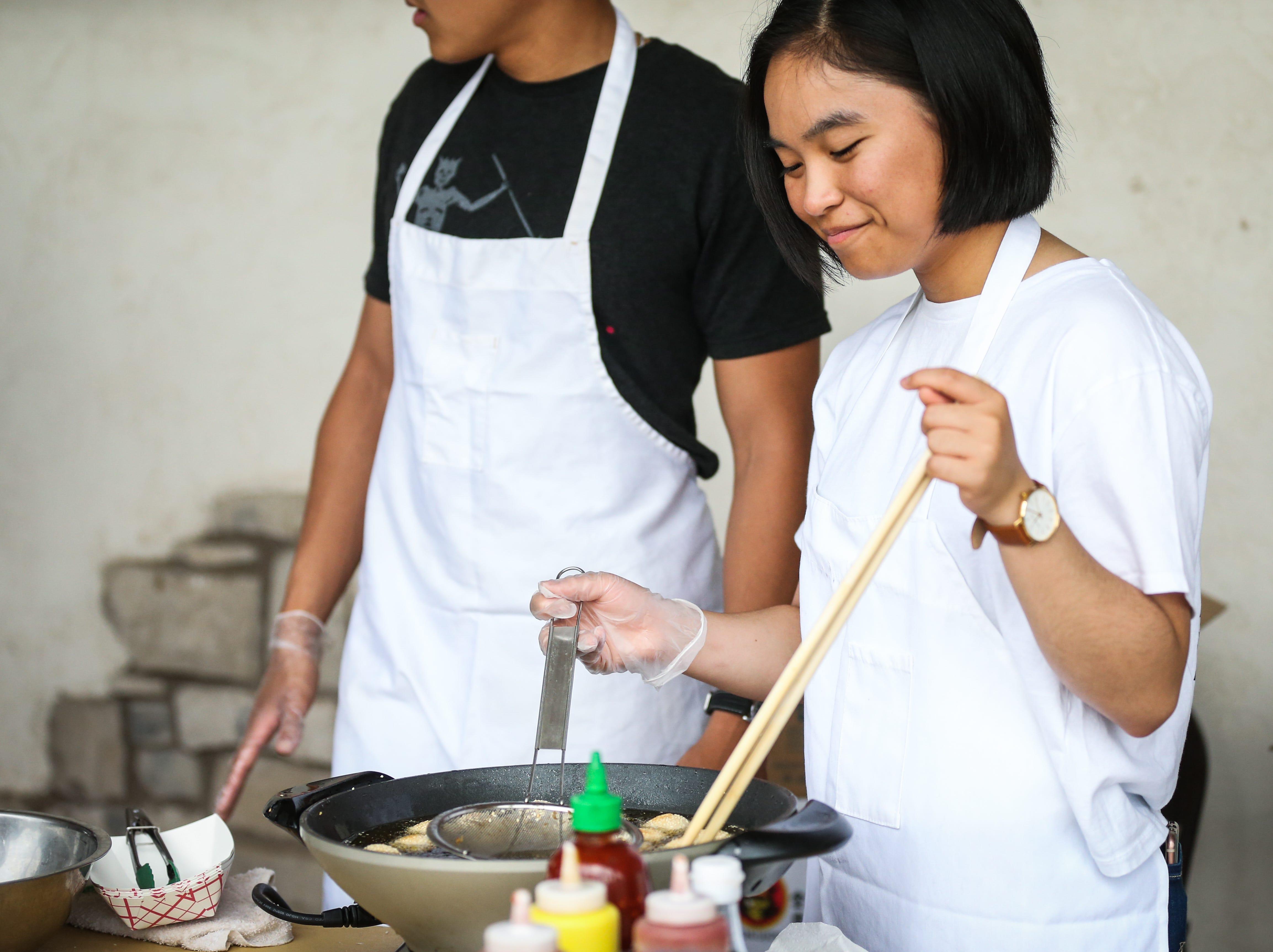 Elizabeth Tran cooks sesame balls during the Asian Bazaar Saturday, Oct. 20, 2018, at El Paseo de Santa Angela.