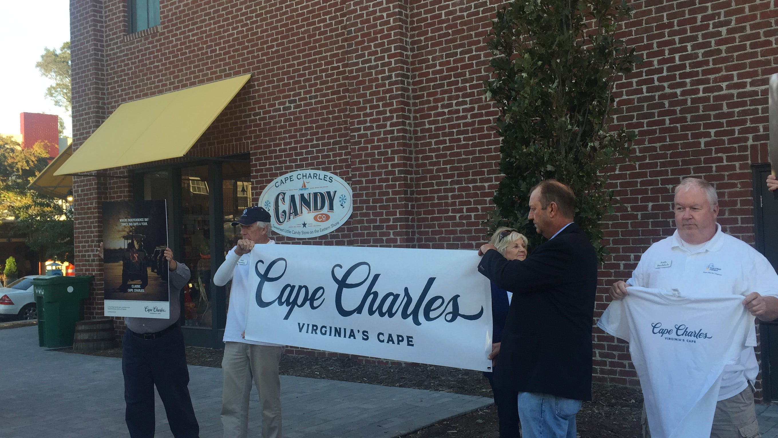 A new brand and logo for the town of Cape Charles is unveiled during a ceremony on Friday, Oct. 19, 2018 in Cape Charles, Virginia.