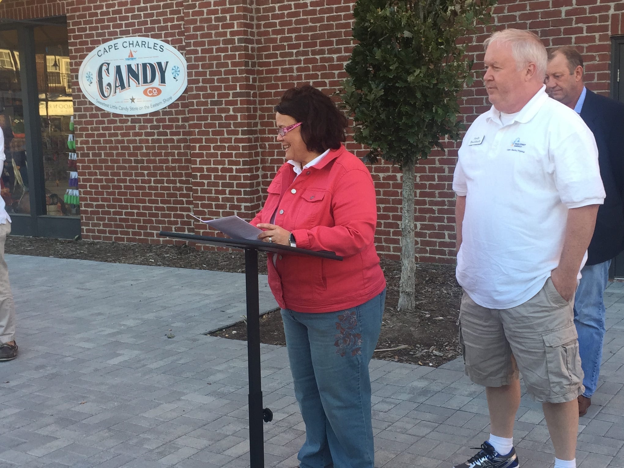Councilwoman Tammy Holloway speaks during a ceremony on Friday, Oct. 19, 2018 to unveil a new brand for the town of Cape Charles, Virginia.