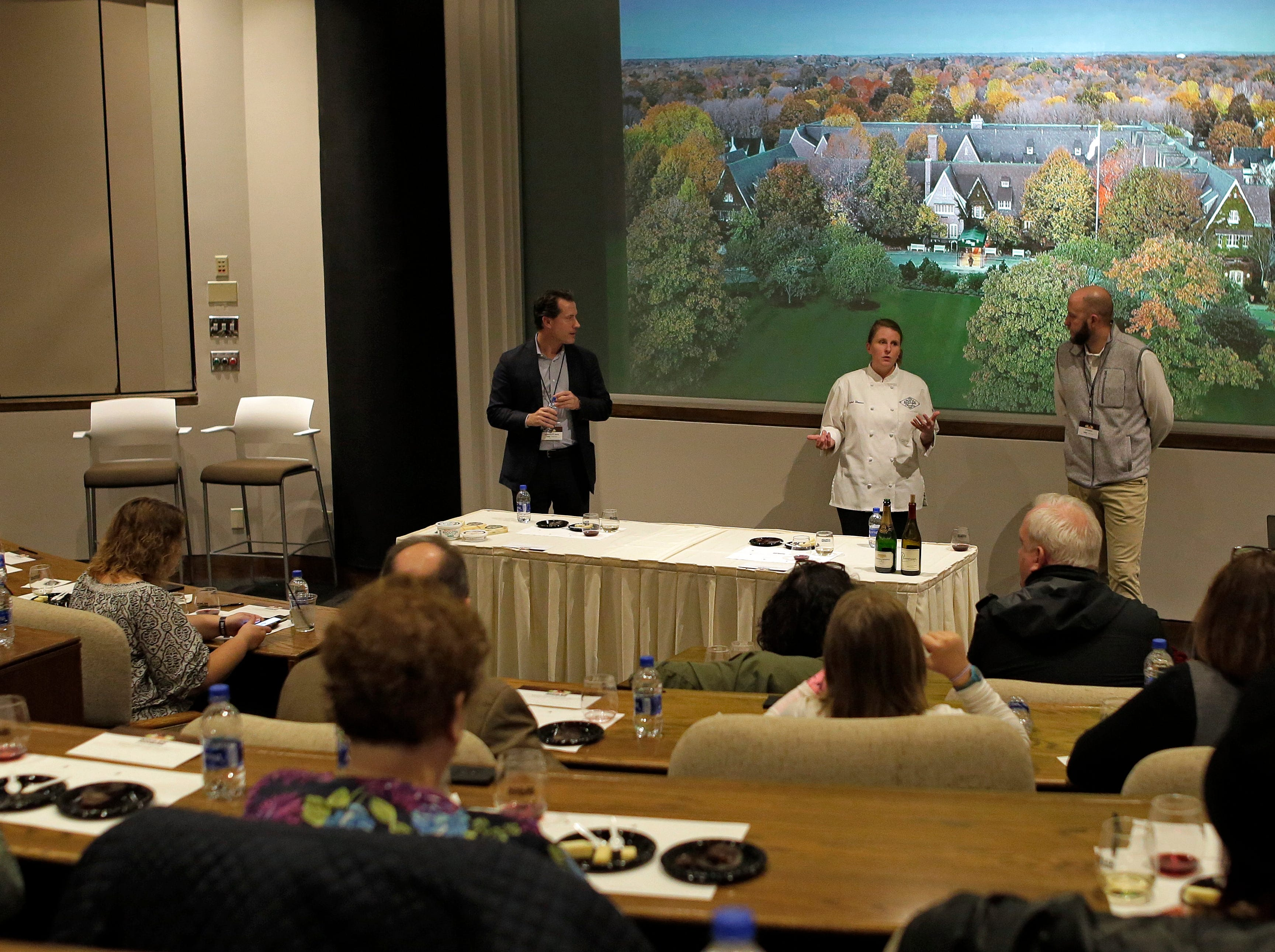 Kohler Chocolatier Crystal Thomas, center in white, explains some of the nuances of chocolate, wine and cheese during a presentation at Kohler Food and Wine, Friday, October 19, 2018, in Kohler, Wis.
