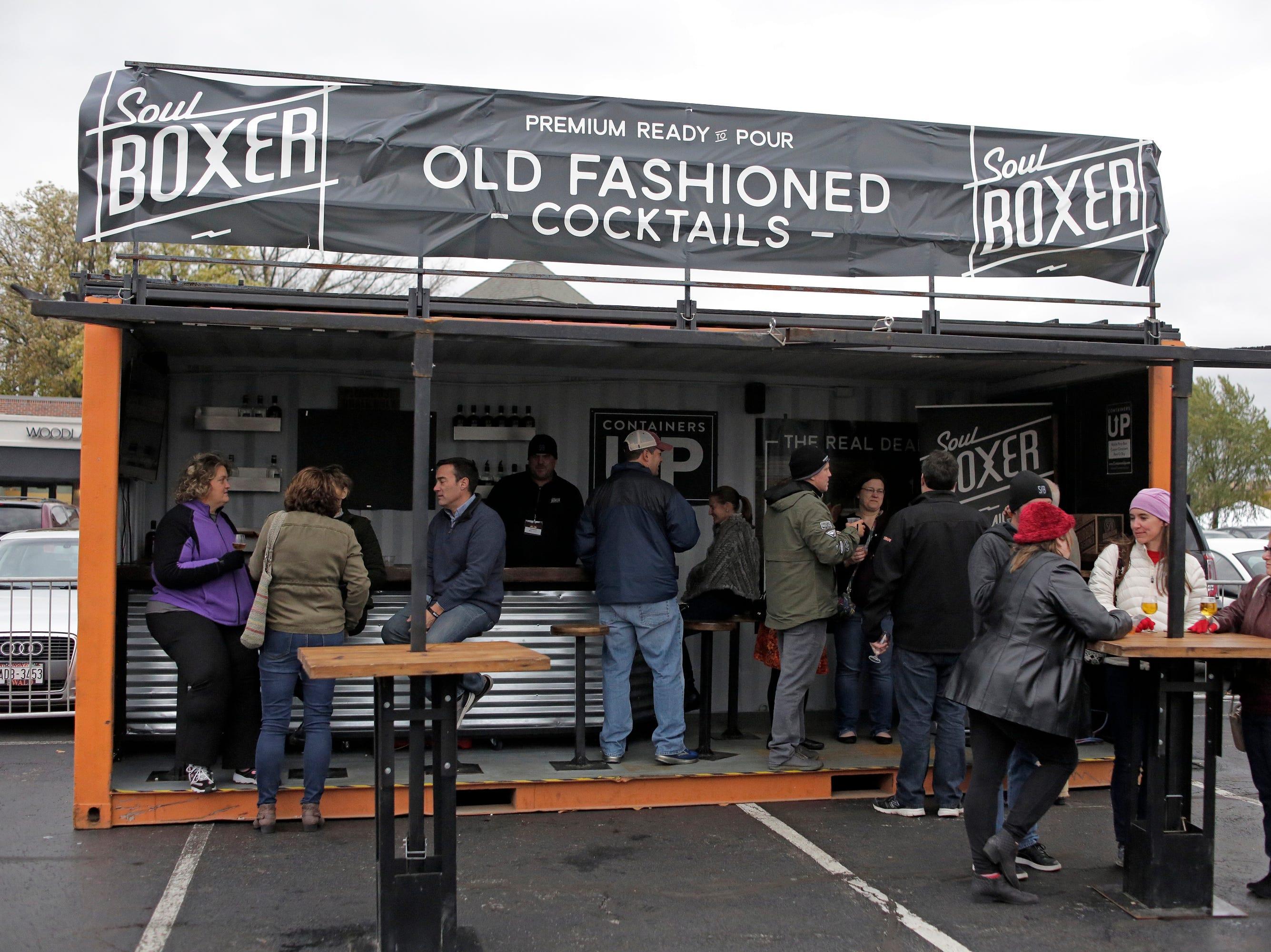 Specialty drink vendors at Kohler Food and Wine, Friday, October 19, 2018, in Kohler, Wis.