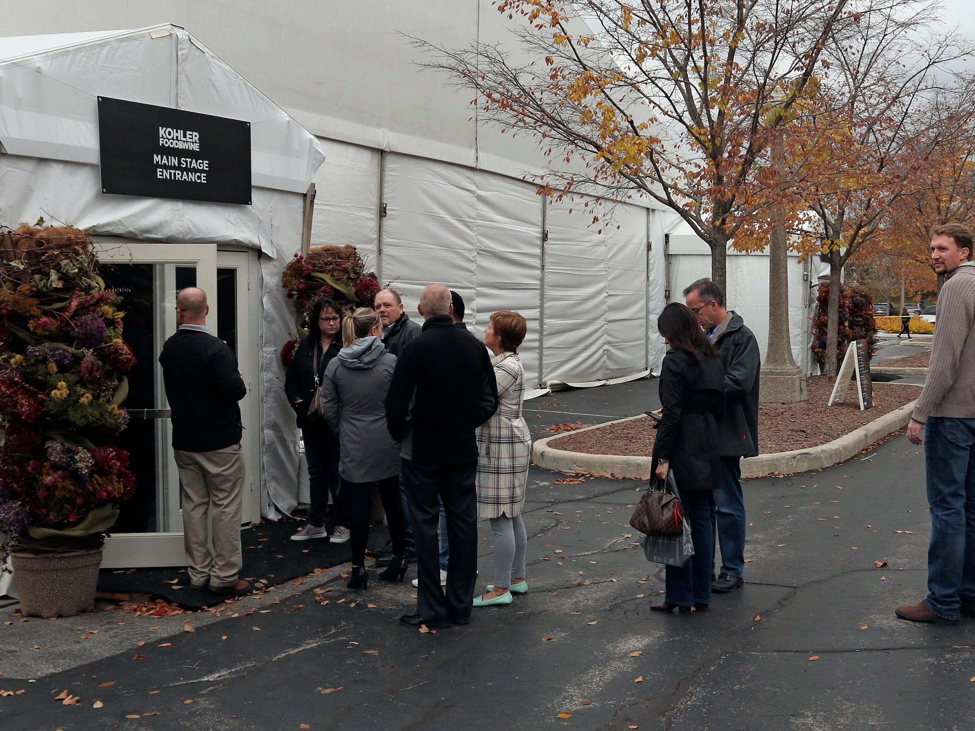 People wait in line to see a presentation at Kohler Food and Wine, Friday, October 19, 2018, in Kohler, Wis.