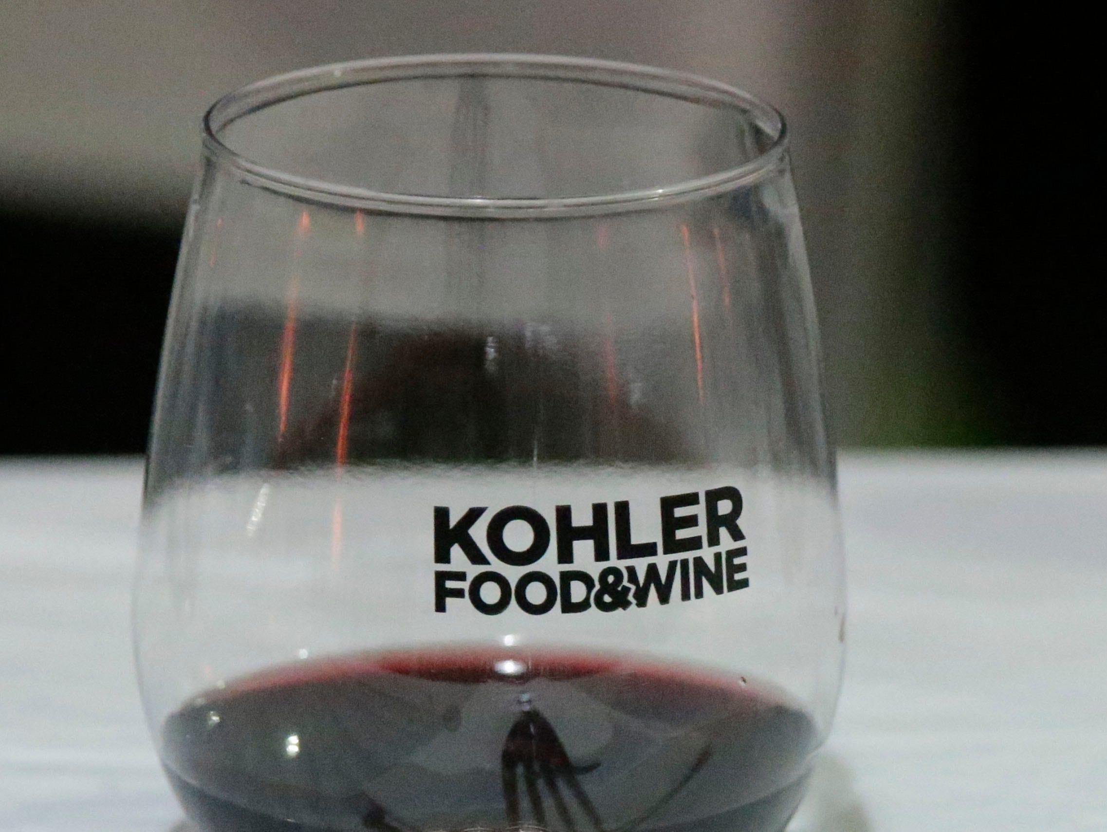 Wine in a glass and a fork ready to take on food sampling at Kohler Food and Wine, Saturday, October 20, 2018, in Kohler, Wis.