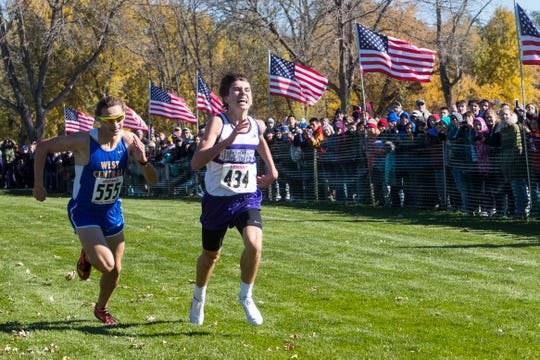 Alec Atwood (434) and Braden Peters (555) compete for position during the Class A boys state cross country meet at Yankton Trail Park in Sioux Falls, S.D., Saturday, Oct. 20, 2018.