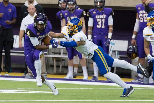 UNI's Deion McShane runs the ball as South Dakota State's Makiah Slade just misses the tackle letting McShane run the ball in for a touchdown during Saturday evening's game.