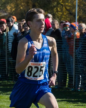 Cody Larson (825) wins the Class B boys state cross country meet at Yankton Trail Park in Sioux Falls, S.D., Saturday, Oct. 20, 2018.