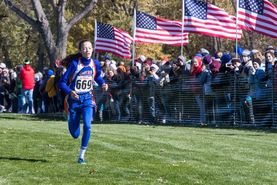 Jolie Dugan (669) wins the Class B girls state cross country meet at Yankton Trail Park in Sioux Falls, S.D., Saturday, Oct. 20, 2018.