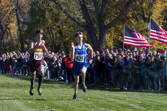 Cody Larson (825) and Thaniel Schroeder (758) compete for position during the Class B boys state cross country meet at Yankton Trail Park in Sioux Falls, S.D., Saturday, Oct. 20, 2018.