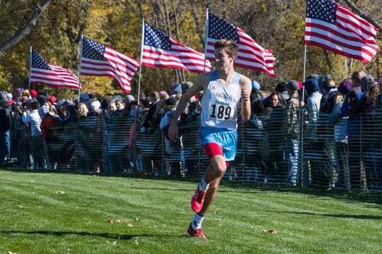 Jack Elliott (189) competes in the Class AA boys state cross country meet at Yankton Trail Park in Sioux Falls, S.D., Saturday, Oct. 20, 2018.