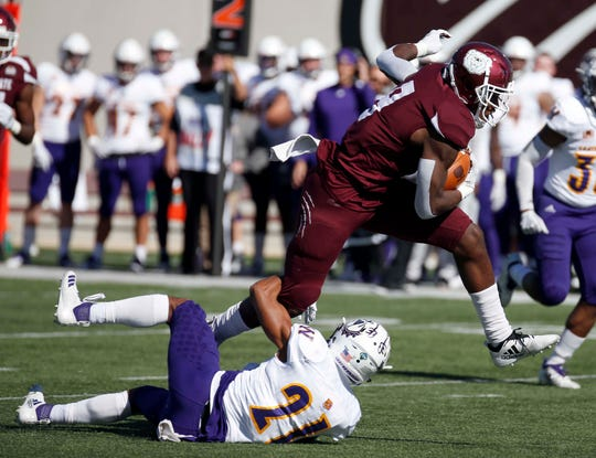 Missouri State's Jordan Murray breaks the last tackle against Western Illinois' Zach Muniz before scoring a touchdown at Plaster Field in Springfield on October 20, 2018.