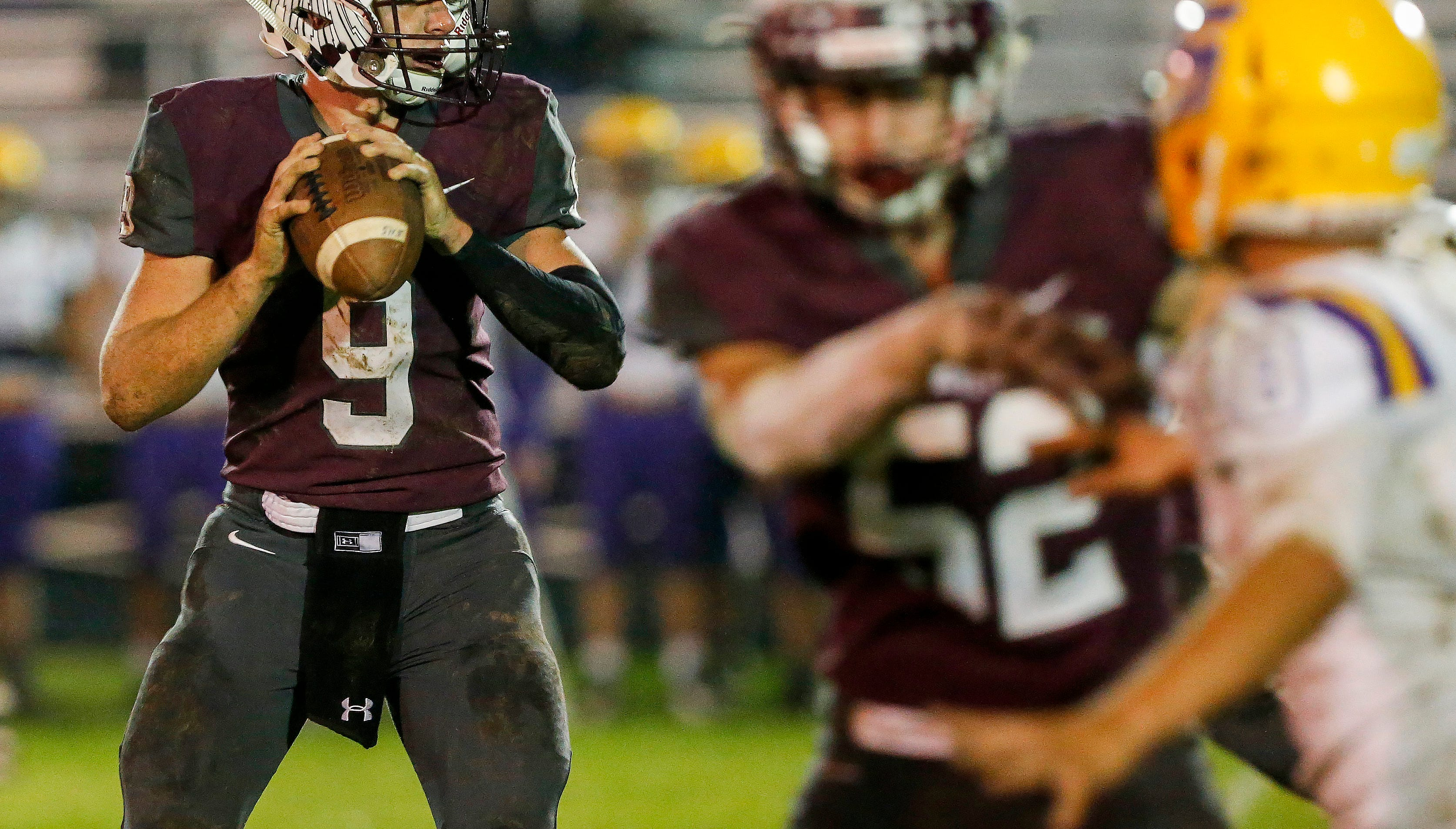 Wyatt Maples of Strafford looks for an open receiver in the Indians win over Slater at Strafford High School on Friday, Oct. 19, 2018.