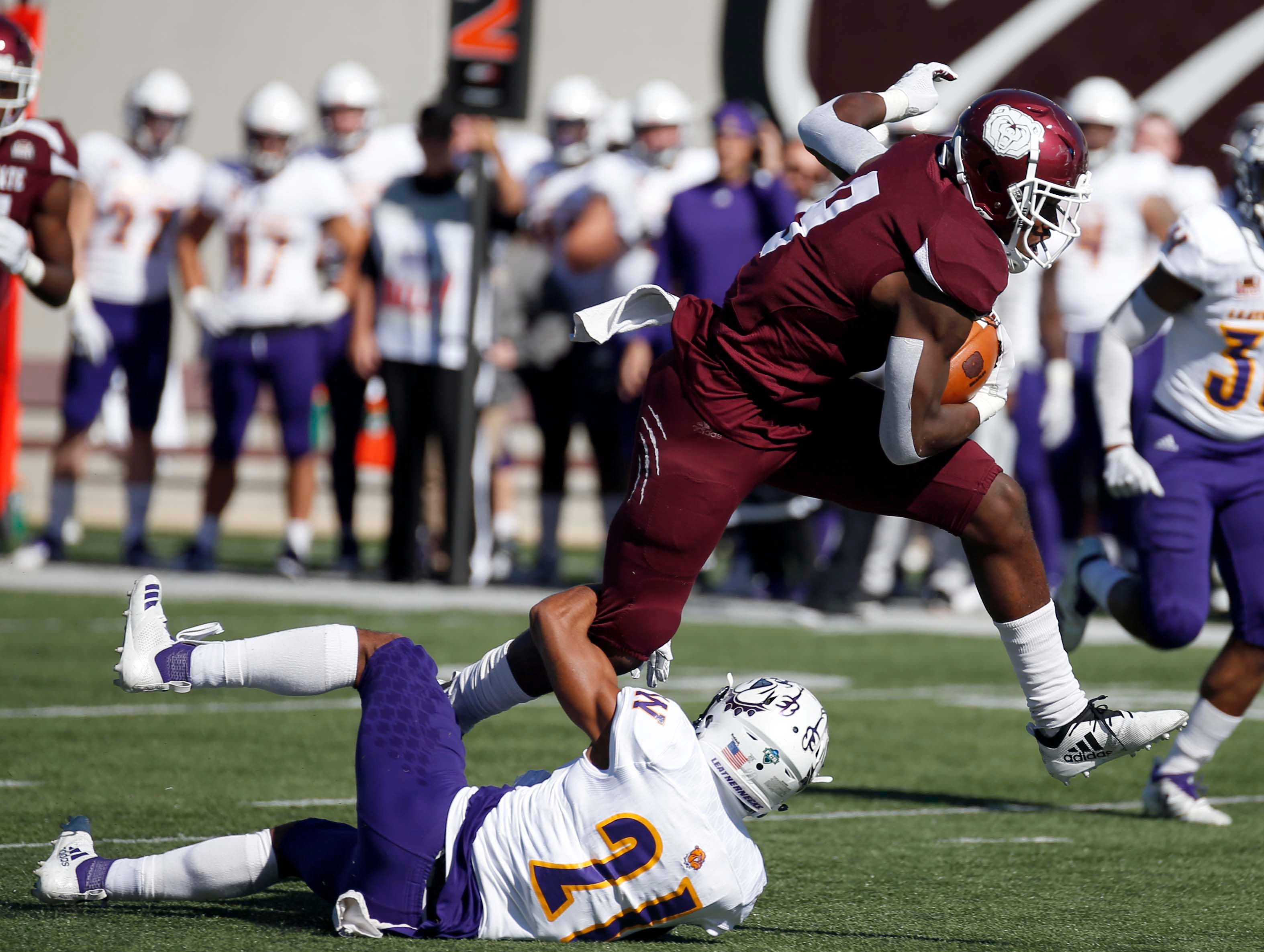 Missouri State's Jordan Murray breaks the last tackle against Western Illinois' Zach Muniz before scoring a touchdown at Plaster Field in Springfield on Oct. 20, 2018.
