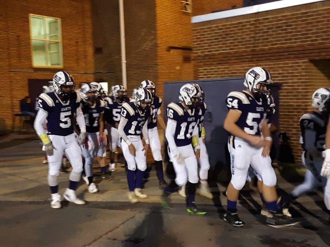 Waynesboro players walk to the field before Friday night's game against Broadway.