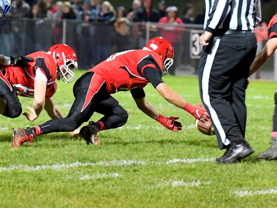Riverheads' players dive to recover a loose ball after it is fumbled by Robert E. Leenduring a football game played in Greenville on Friday, Oct. 19, 2018.