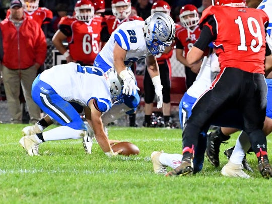 Robert E. Lee quarterback William Dod (left) and teammate Garrett Lawler scramble to recover the ball after it is fumbled during a football game played in Greenville on Friday, Oct. 19, 2018.