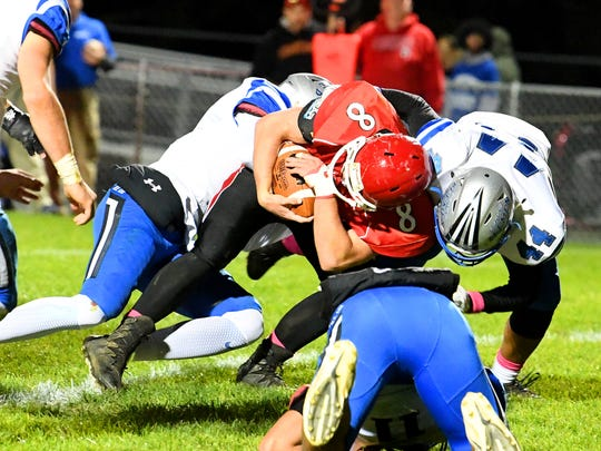 Riverheads' Zac Smiley protects the ball as Robert E. Lee's Ethan Vest helps make the tackle during a football game played in Greenville on Friday, Oct. 19, 2018.