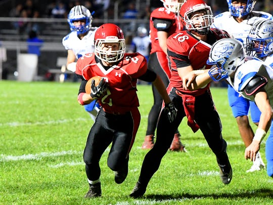 Riverheads' Devin Morris tries to run the ball around and past Robert E. Lee's William Dod during a football game played in Greenville on Friday, Oct. 19, 2018.