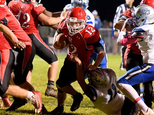 Riverheads' Cy Cox finds a hole in the Robert E. Lee defensive line and squeezes through with the ball as he heads to the end zone for a touchdown during a football game played in Greenville on Friday, Oct. 19, 2018.