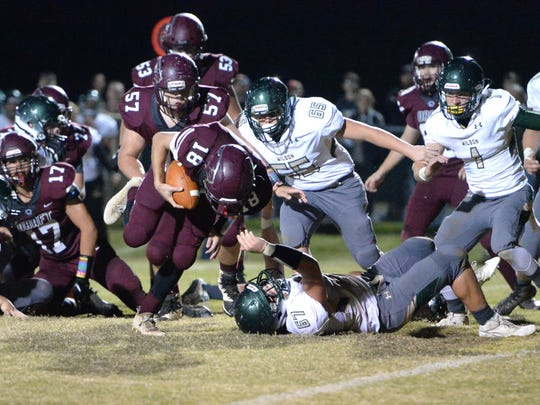 Stuarts Draft's Blake Roach (18) breaks out of the pack and scores a touchdown to temporarily put the Cougars in front late in Friday night's game against Wilson.