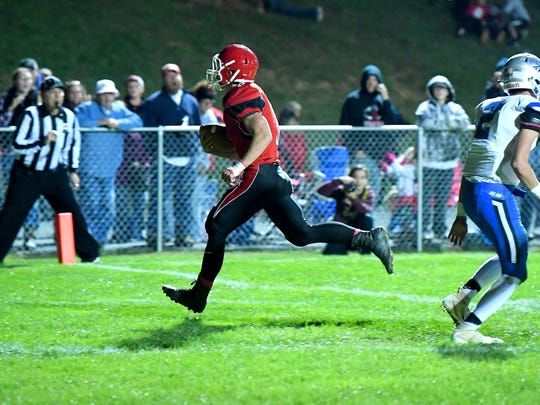 Riverheads' Zac Smiley runs the football into the end zone for a touchdown during a football game played in Greenville on Friday, Oct. 19, 2018.