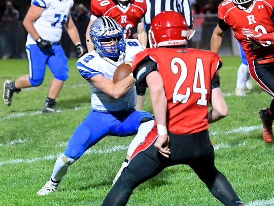 Robert E. Lee quarterback William Dod tries to take the ball around Riverheads' Jaden Phillips on a quarterback keep during a football game played in Greenville on Friday, Oct. 19, 2018.