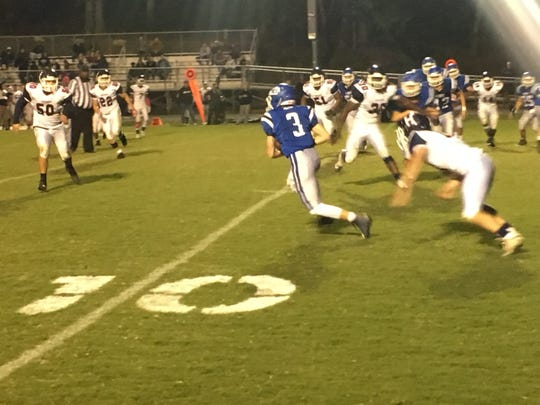 Fort Defiance's Cole Sligh eludes a Harrisonburg tackler on a 14-yard pass play.