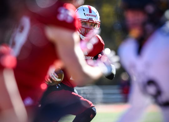 St. John's quarterback Jackson Erdmann looks for an open receiver during the first half of the Saturday, Oct. 20, game against St. Olaf at Clemens Stadium in Collegeville