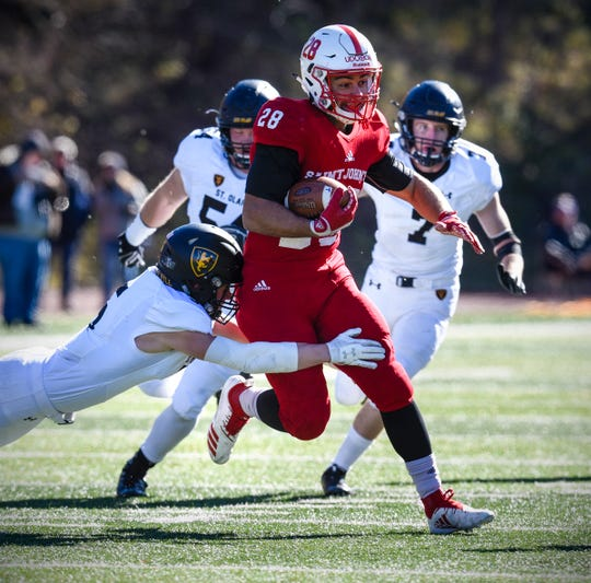 Kenneth Udoibok rushes for St. John's during the first half of the Saturday, Oct. 20, game against St. Olaf at tClemens Stadium in Collegeville