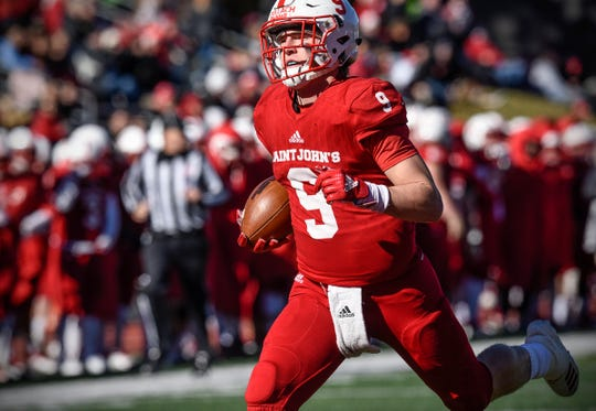 Will Gillach rushes for a St. John's touchdown during the first half of the Saturday, Oct. 20, game against St. Olaf at Clemens Stadium in Collegeville