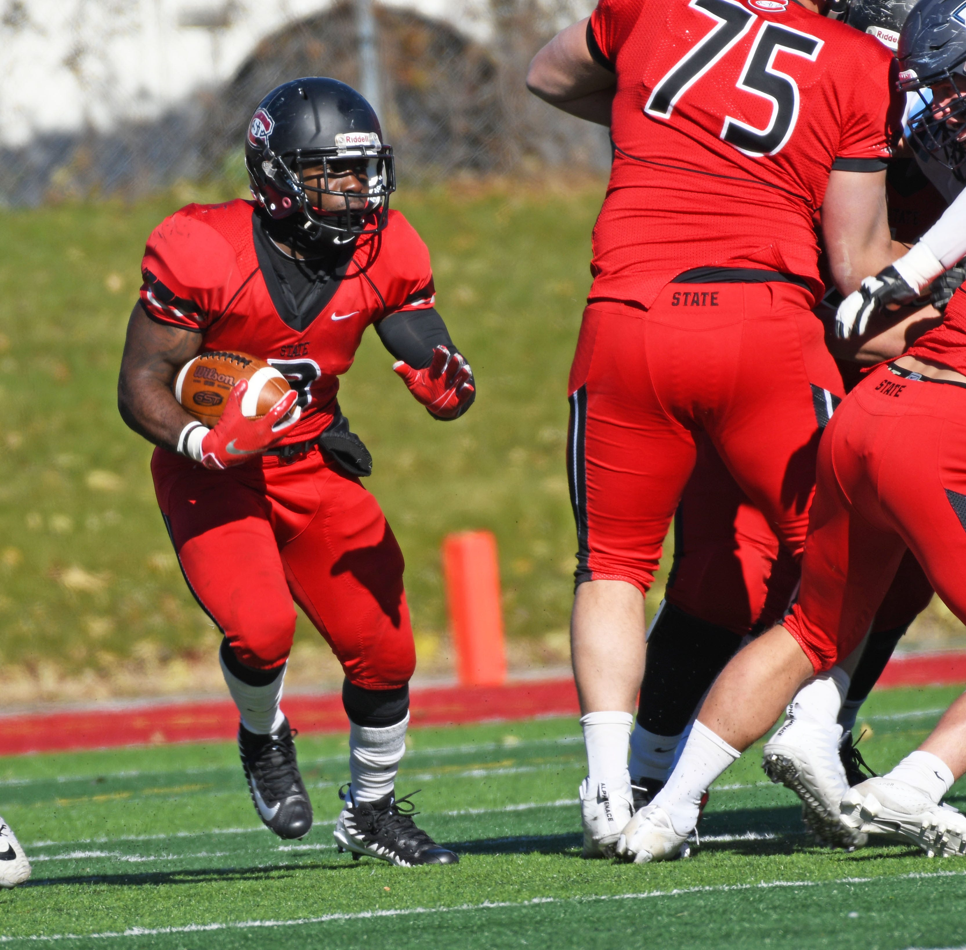 St. Cloud State senior running back Gregory Lewis carries the ball against Upper Iowa on Saturday at Husky Stadium. Lewis had 36 carries for 167 yards and a touchdown in the Huskies' 34-14 homecoming win.