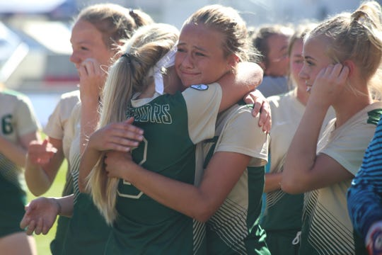 Heidi Smith hugs a teammate following Snow Canyon's 1-0 win over Orem in the 4A state championship in Sandy on Oct. 21, 2018.