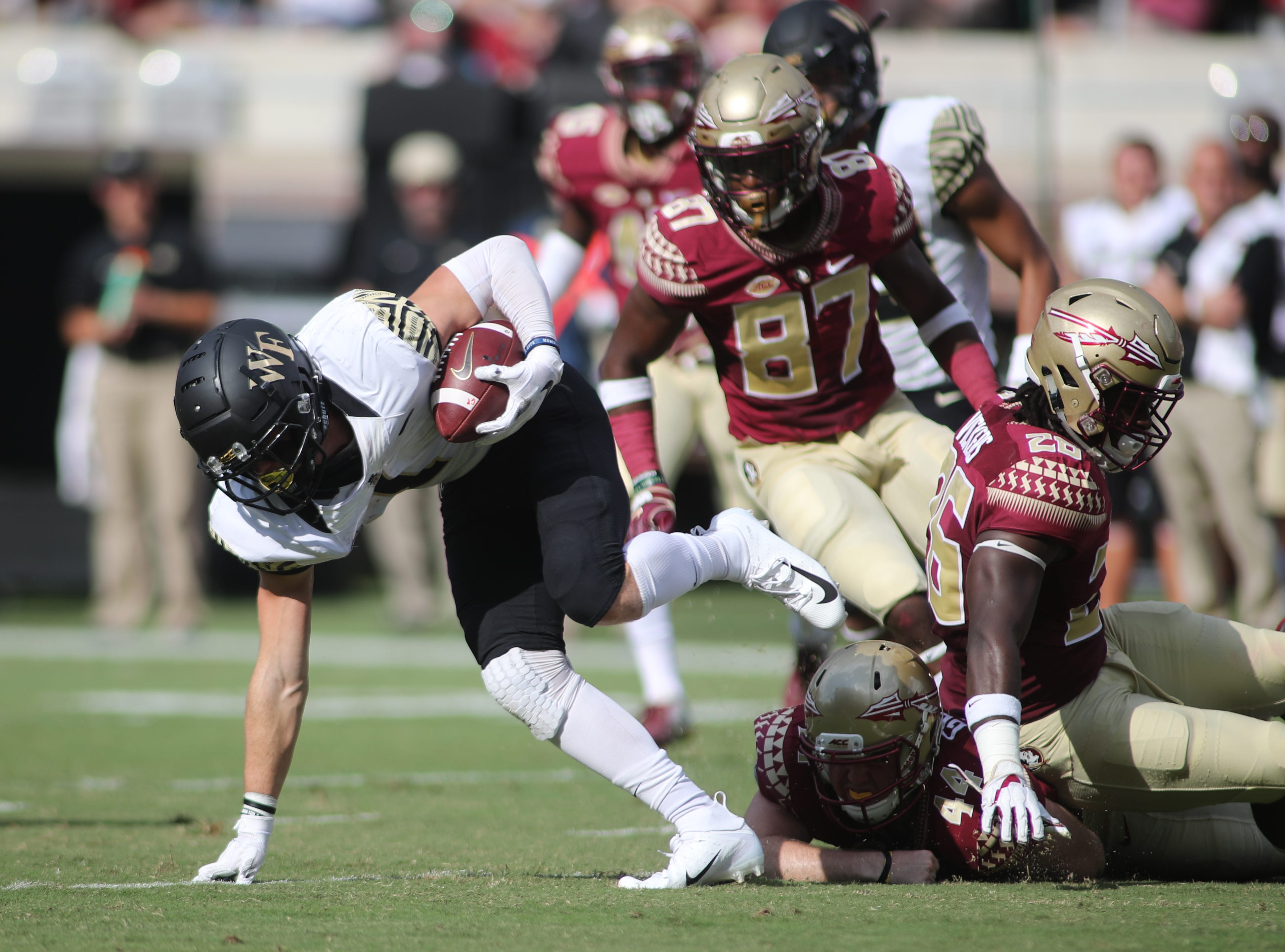 Wake Forest Demon Deacons wide receiver Alex Bachman (1) breaks a tackle during FSU's homecoming game against Wake Forest at Doak S. Campbell Stadium Saturday, Oct. 20, 2018.