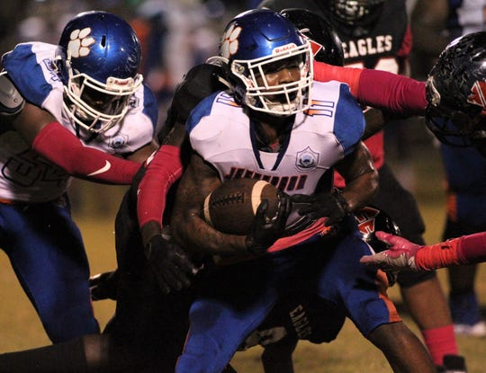 Jefferson County receiver Da'Shon Davis is swarmed by three NFC defenders after a short catch Friday.
