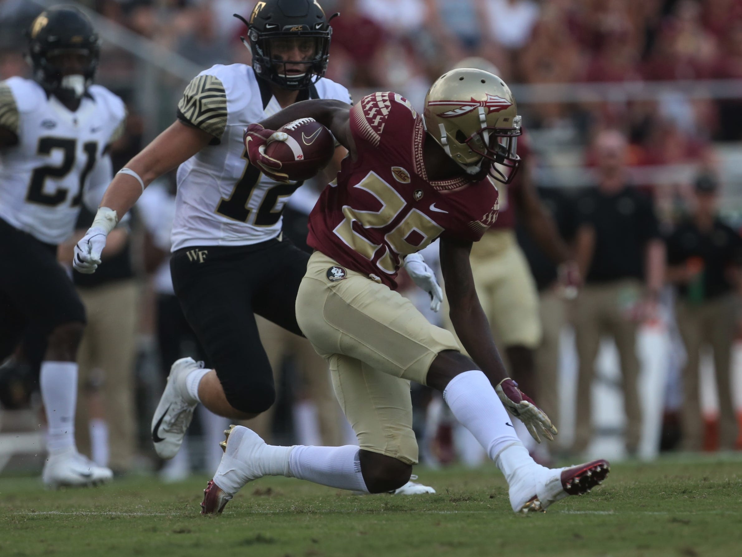 Florida State's D.J. Matthews puts on the brakes on a punt return as Wake Forest's Luke Masteron approaches for a tackle during a game at Doak Campbell Stadium on Saturday, Oct. 20, 2018.