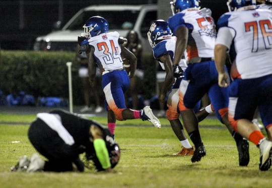 Jefferson County linebacker GeKobe Smith races 45 yards for a fumble return touchdown after a strip-sack of NFC quarterback J.D. Jerry in the second quarter of Friday night's game.