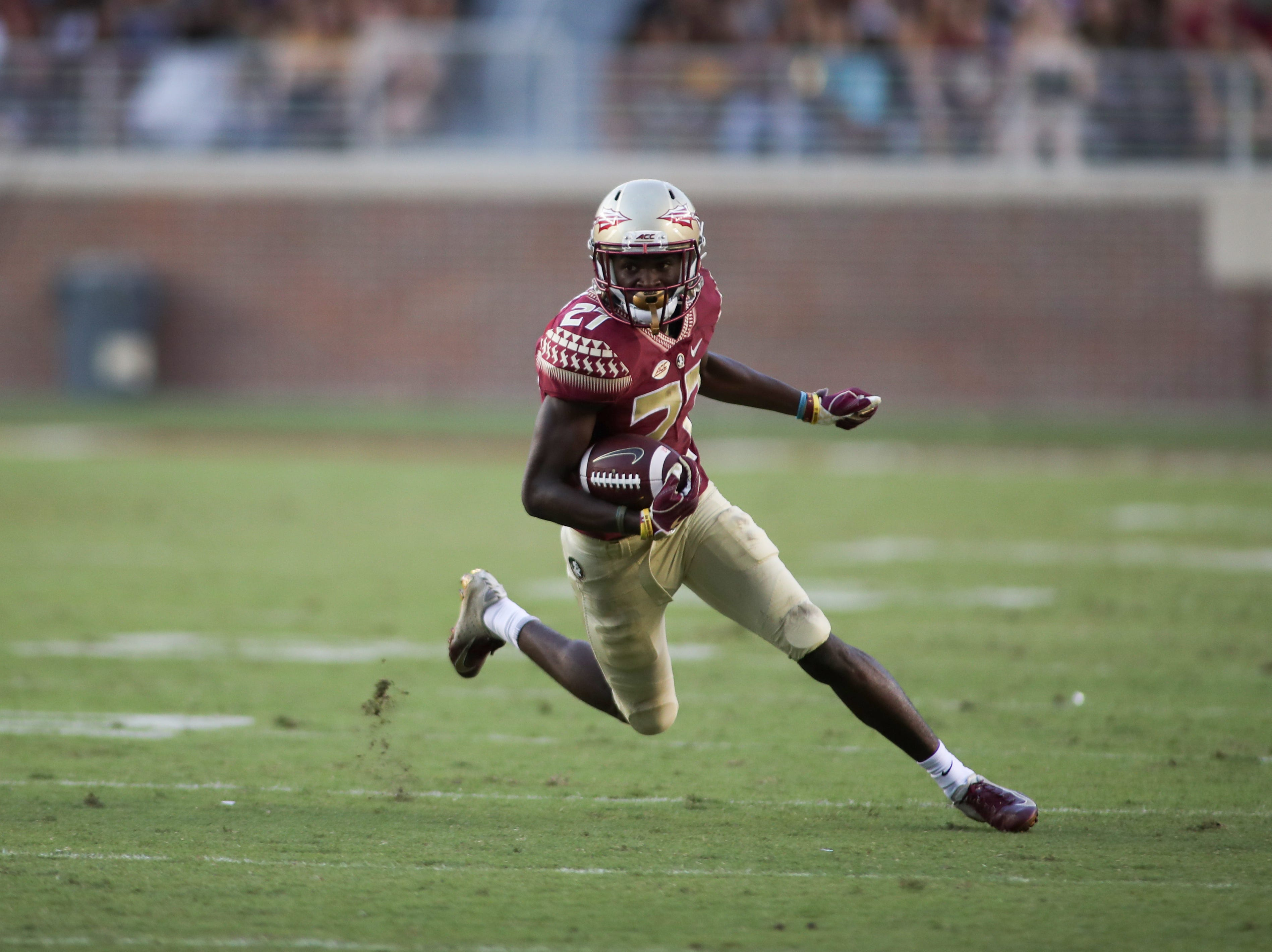 Florida State Seminoles wide receiver Ontaria Wilson (27) runs the ball during FSU's homecoming game against Wake Forest at Doak S. Campbell Stadium Saturday, Oct. 20, 2018.
