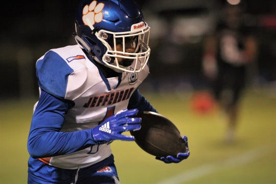 Jefferson County receiver Armon Williams runs after a catch during a game at NFC on Friday, Oct. 19, 2018.