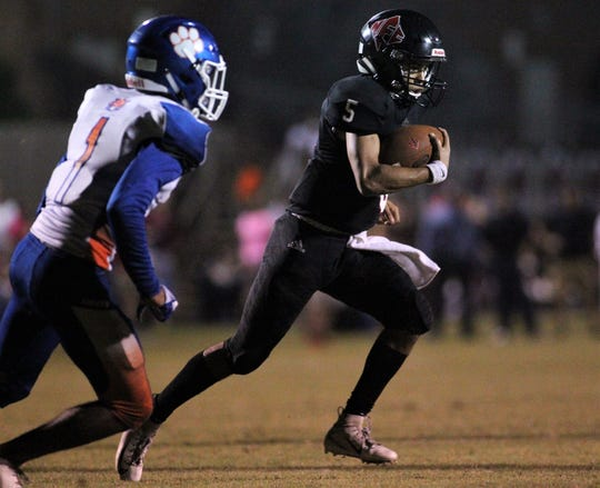 NFC quarterback J.D. Jerry runs for a 27-yard touchdown against Jefferson County on Friday night.