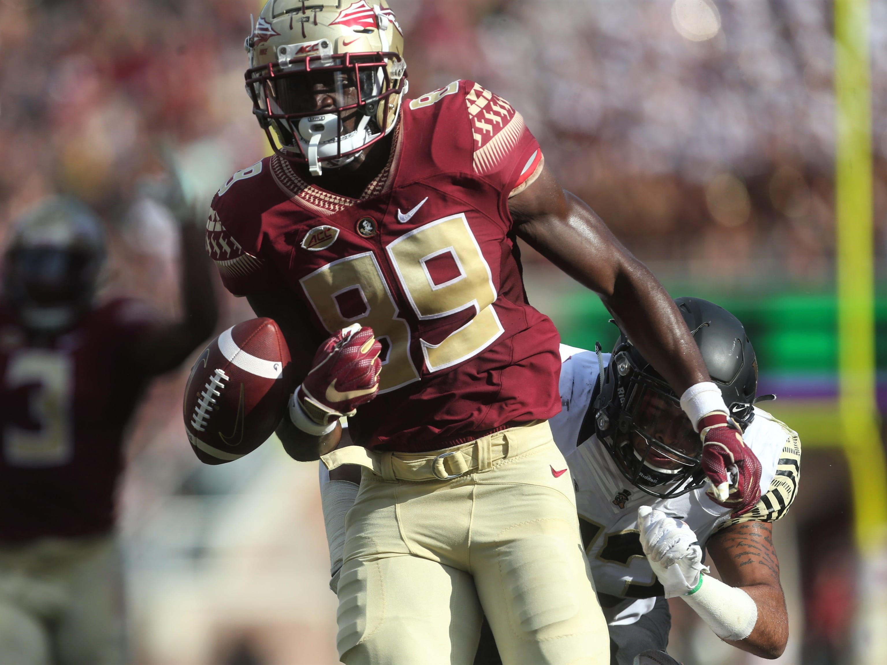 Florida State receiver Keith Gavin races to outrun Wake Forest linebacker Justin Strnad towards the goal line after a catch and run against Wake Forest, but Strnad caused a fumble with a punch during a game at Doak Campbell Stadium on Saturday, Oct. 20, 2018.