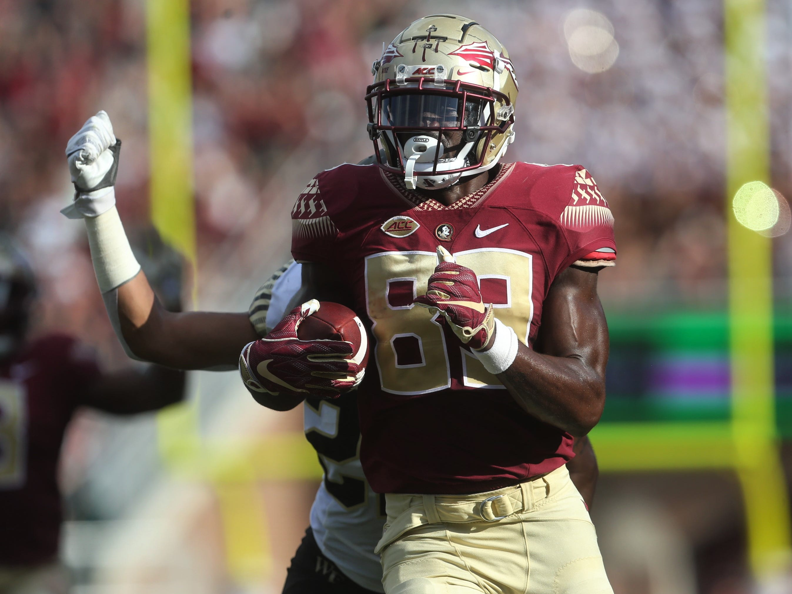 Florida State receiver Keith Gavin races to outrun Wake Forest linebacker Justin Strnad towards the goal line after a catch and run against Wake Forest during a game at Doak Campbell Stadium on Saturday, Oct. 20, 2018.