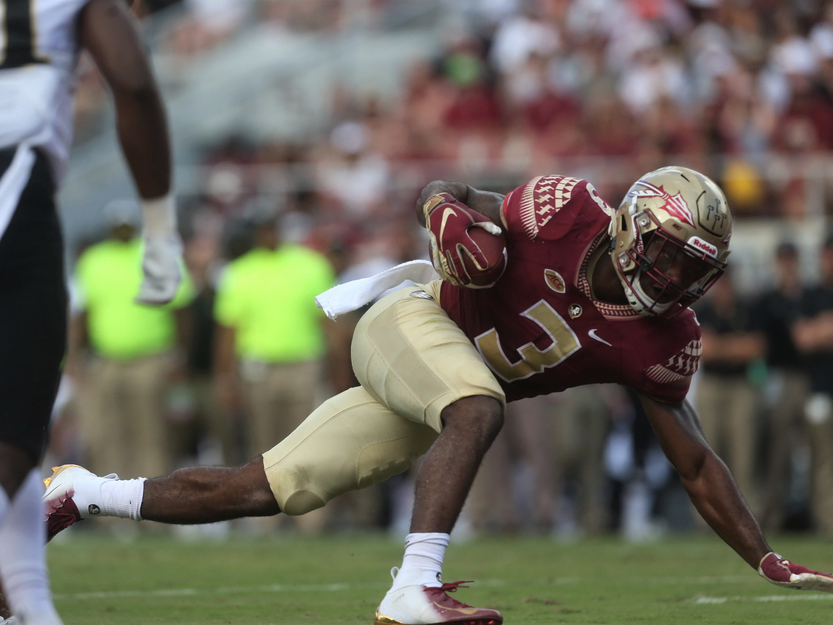 Florida State running back Cam Akers escapes Wake Forest tacklers to score a three-yard rushing touchdown in the first quarter of a game at Doak Campbell Stadium on Saturday, Oct. 20, 2018.